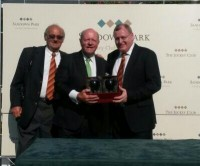 Global Leader\'s owner Jim Kinnear (centre) receiving his prize at Sandown.