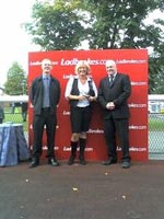 SU GAY OF GREENSTEAD HALL RACING RECEIVES HER TROPHY FOR SUZI\'S DECISION\'S WIN AT LEICESTER ON 17TH SEPTEMBER.